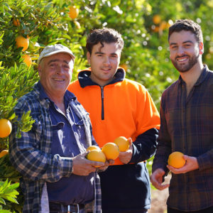 Nudie Farmers Holding Fresh Oranges