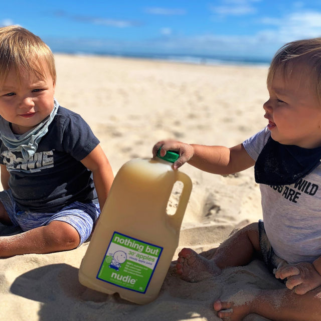 Life's a beach when you've got nothing but 30 apples and your bestie by your side!#nudie #juice #nudiejuice #nothingbut #nothingbutjuice #nothingbutapples #apples #fruit #anappleaday #beach #besties #sand #sun #surf #creatorsofgood
